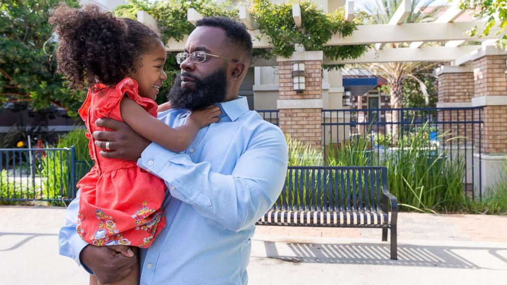 Walter Daniel plays with daughter Victoria near their apartment in Dublin, Calif., on Sept. 27, 2018.