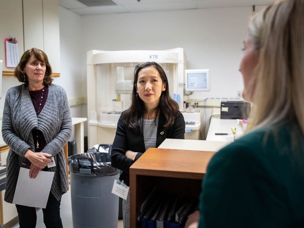 PHOTO: Dr. Leana Wen, president of Planned Parenthood, speaks with staff of Planned Parenthood Mar Monte in a basement lab that runs tests for gonorrhea and chlamydia.