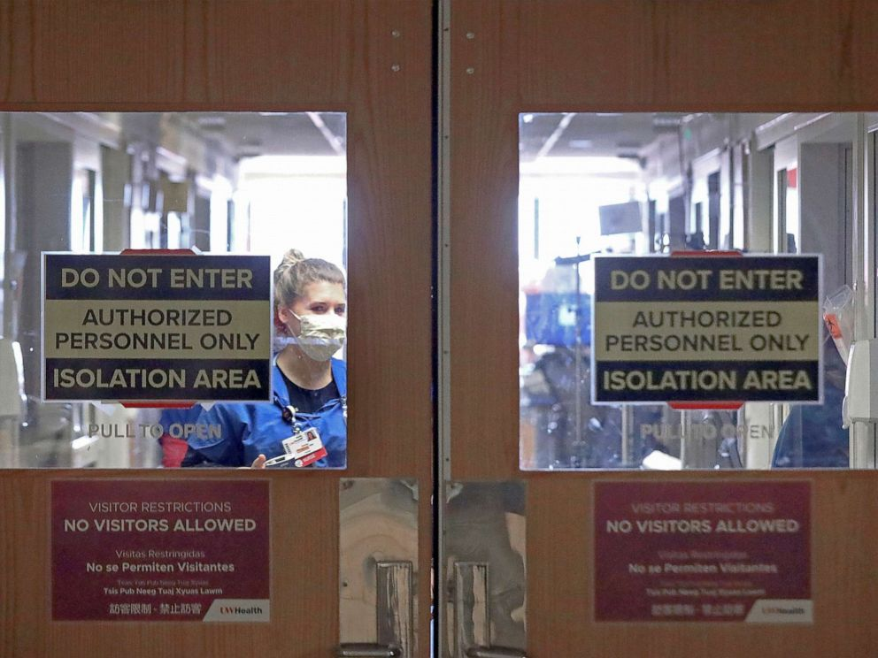 PHOTO: Doors to a COVID-19 treatment unit at UW Health in Madison, Wis. caution hospital personnel and visitors, Nov. 5, 2020.