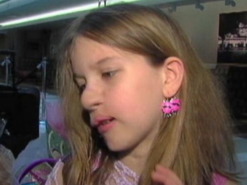 PHOTO: Charlotte wears two earrings in her left ear, while she waited for her right ear to be attached.