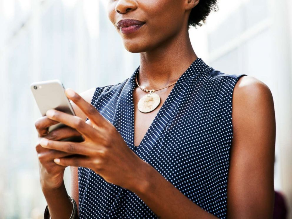 PHOTO: A woman holds a cell phone in this undated stock photo.