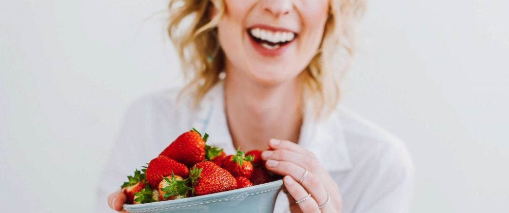 PHOTO: A woman eats strawberries in this undated stock photo.