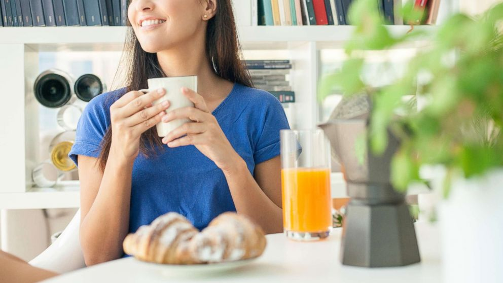 In this undated stock photo, a young woman having breakfast at home.