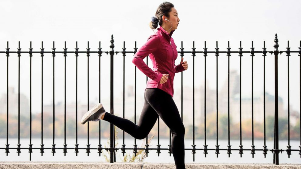 A woman is seen running on a waterfront path in this undated stock photo.