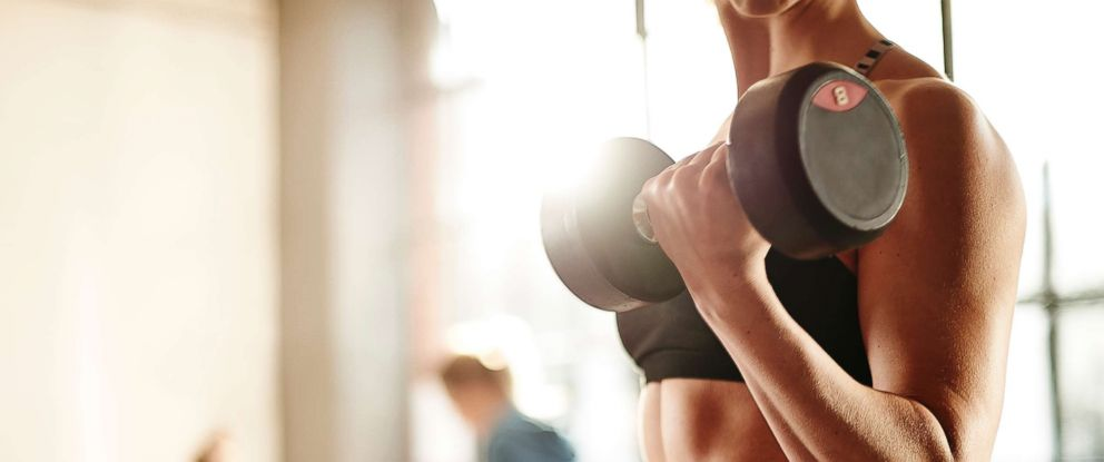 PHOTO: A woman lifts dumbbells in a gym in this undated stock photo.