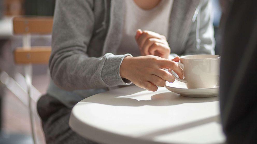 Woman having coffee.