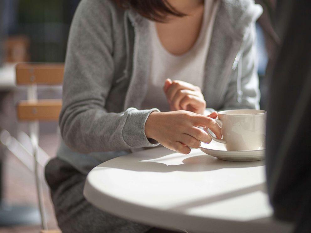 PHOTO: Woman having coffee.