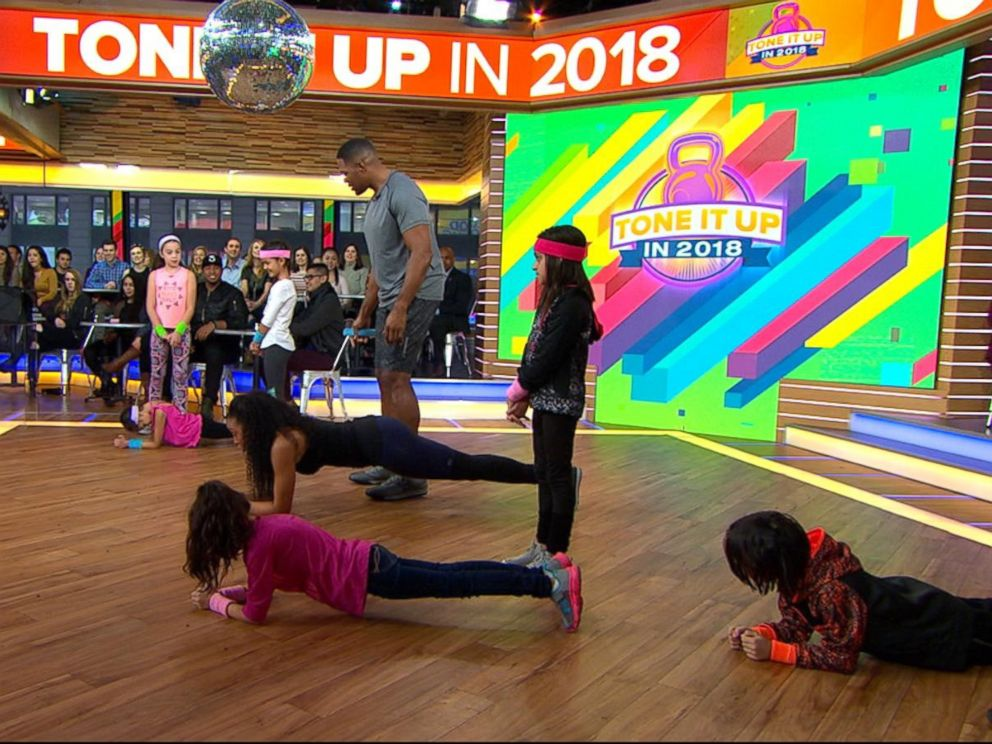PHOTO: GMA anchor Michael Strahan and celebrity trainer Latreal Mitchell demonstrate a partner workout move, Jan. 12, 2018.