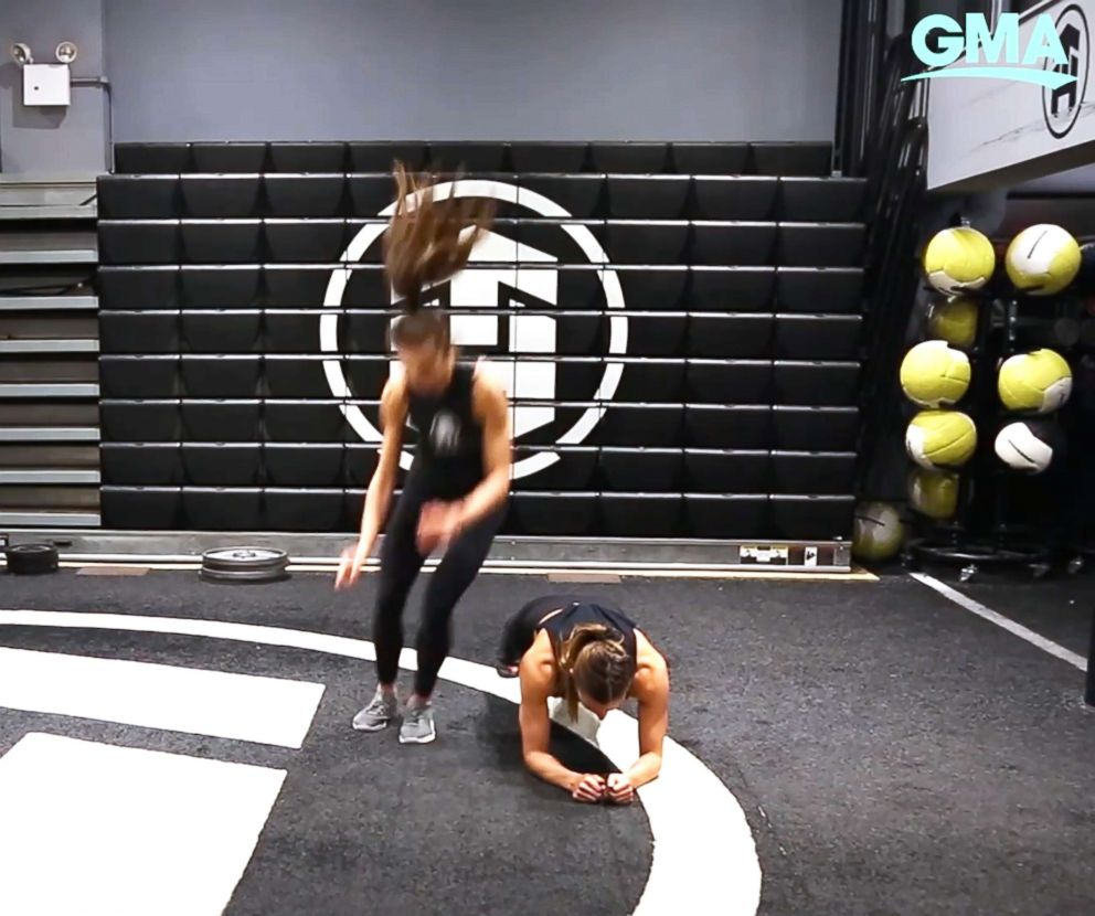 PHOTO: Tone House trainers demonstrated burpee drop-down jump overs.