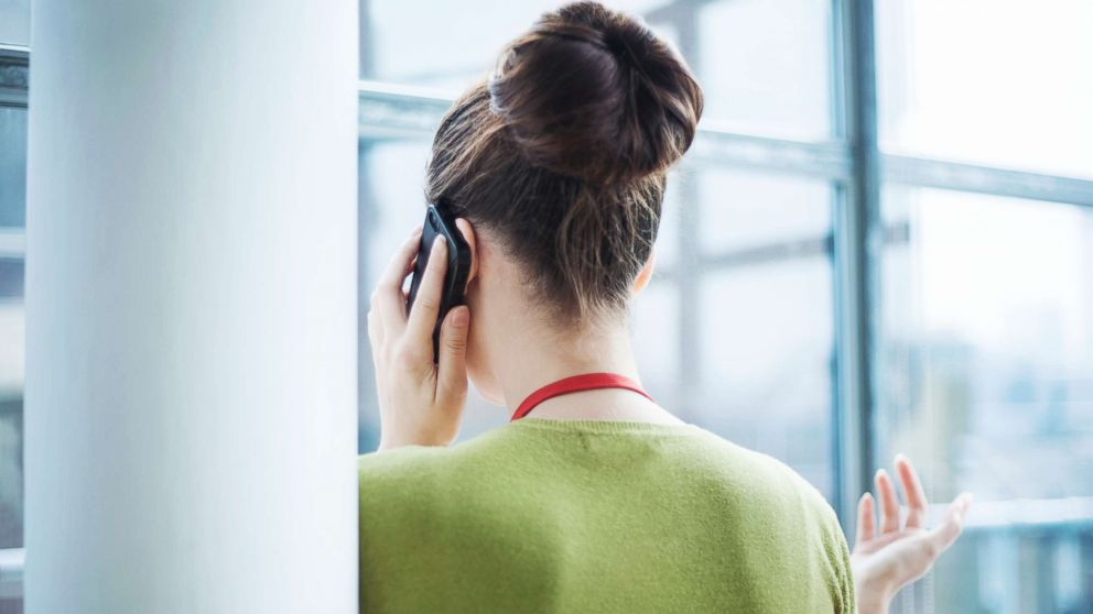 In this undated stock photo, a young woman talking on a cell phone.