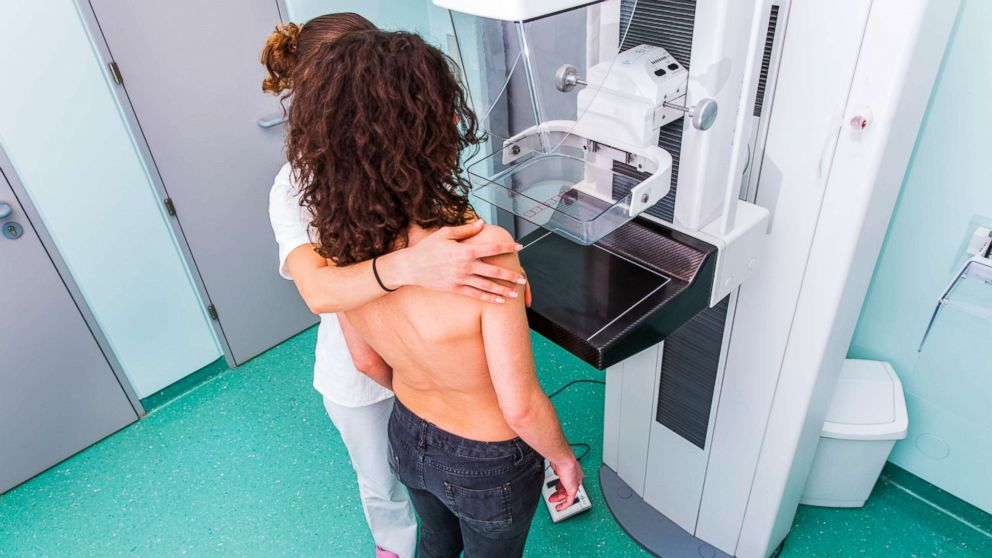In this undated stock photo, a nurse is giving a young women a mammography exam.