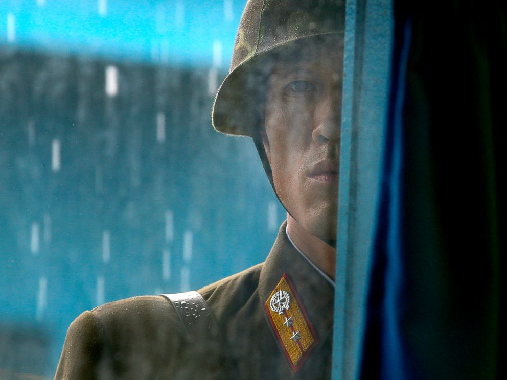 PHOTO: A North Korean soldier looks through the window of the building that sits on the Demilitarized Zone (DMZ) in Panmunjom, South Korea, that separates the two Koreas, July 21, 2010.