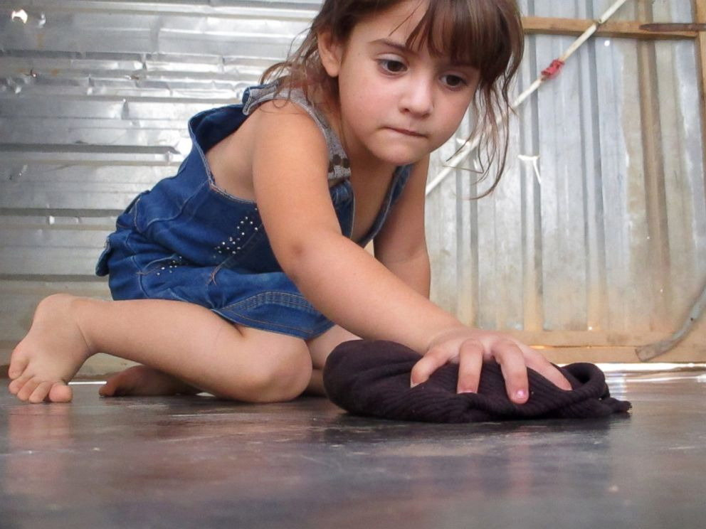 PHOTO: My cute little sister Farah helps out with chores in the house.