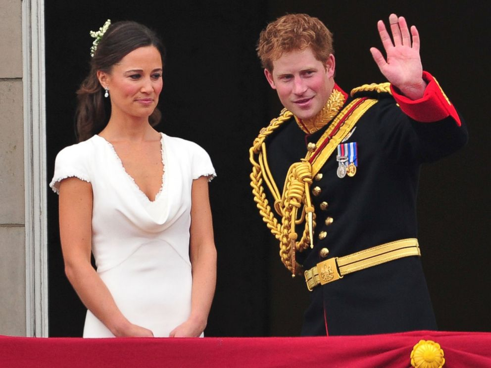 PHOTO: Pippa Middleton and Prince Harry greet crowd of admirers from the balcony of Buckingham Palace, April 29, 2011 in London.