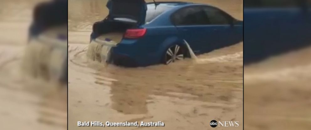 VIDEO: Raging floodwaters from Tropical Cyclone Debbie flow through a completely submerged car in Queensland, Australia.