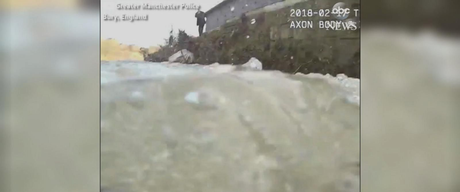 This police bodycam footage shows an officer jumping into a river to pull a distressed man to safety.
