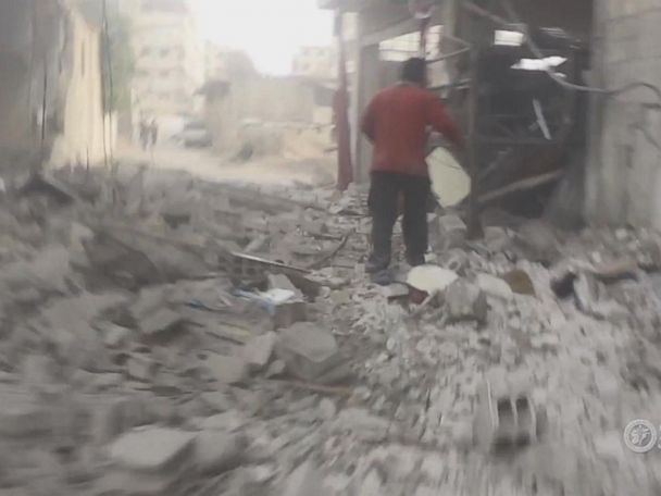 WATCH:  Cameraman pulls his own family from rubble