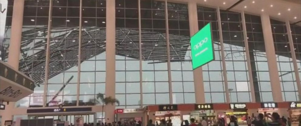 Travelers at the Nanchang Changbei International Airport in southeast China watch as part of the buildings roof collapses.