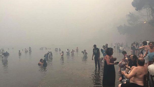 People escape the wildfires in Mati, Greece