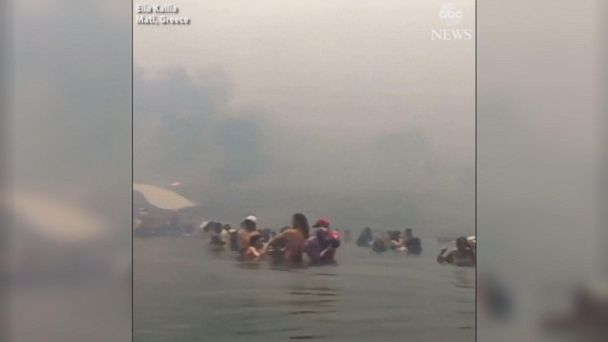 People flee into sea to escape Greek wildfires