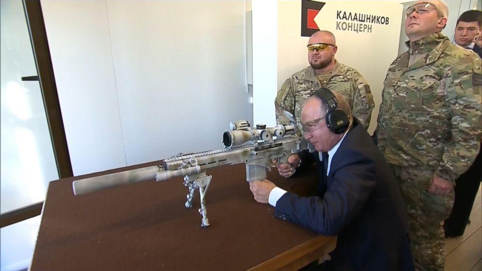 Vladimir Putin poses with new Kalashnikov sniper rifle - ABC