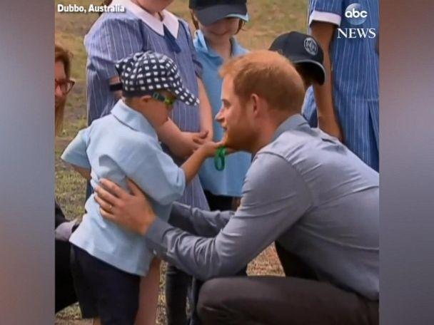 WATCH:  Five-year-old boy rubs Prince Harry's beard and gives him a hug