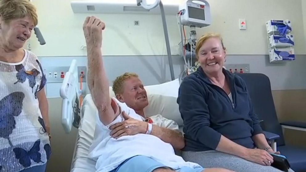 Paul Kenny, 50, was surfing off Samurai Beach in New South Wales on Saturday morning when he was bitten by a shark in the right bicep.