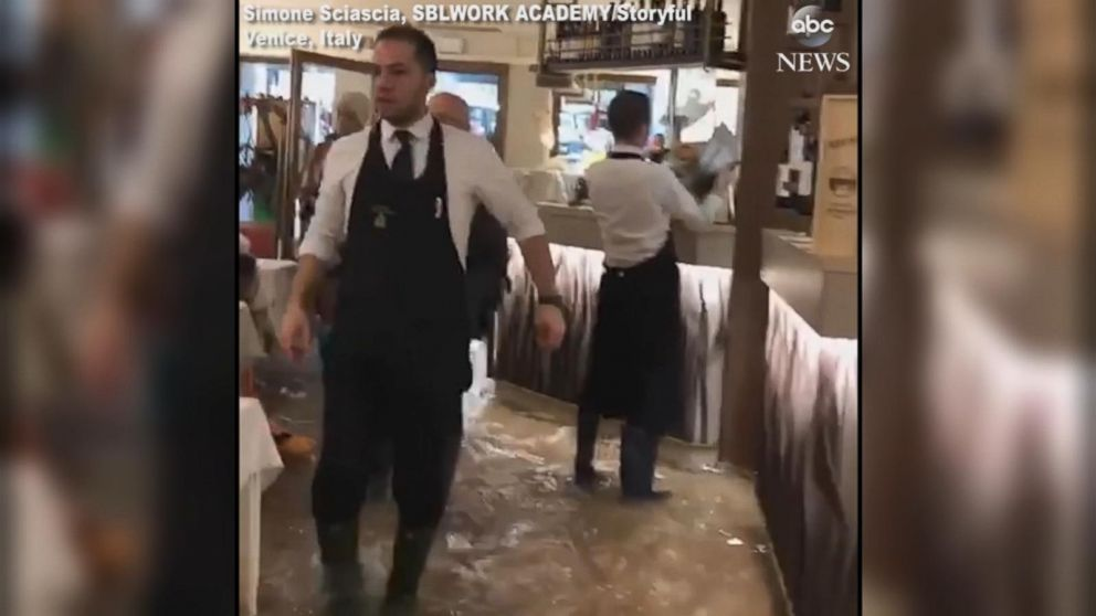 VIDEO: Venice pizzeria dishes out slices despite flooding