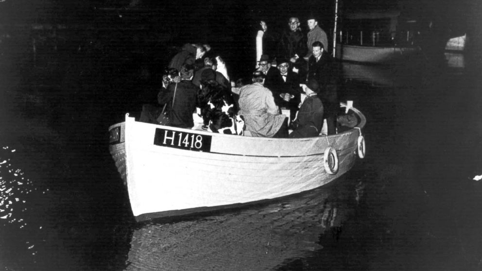 This 1943 photo shows a boat carrying people during the escape across the Oresound of some of 7,000 Danish Jews who fled to safety in neighboring Sweden three years after the German Nazi invasion.
