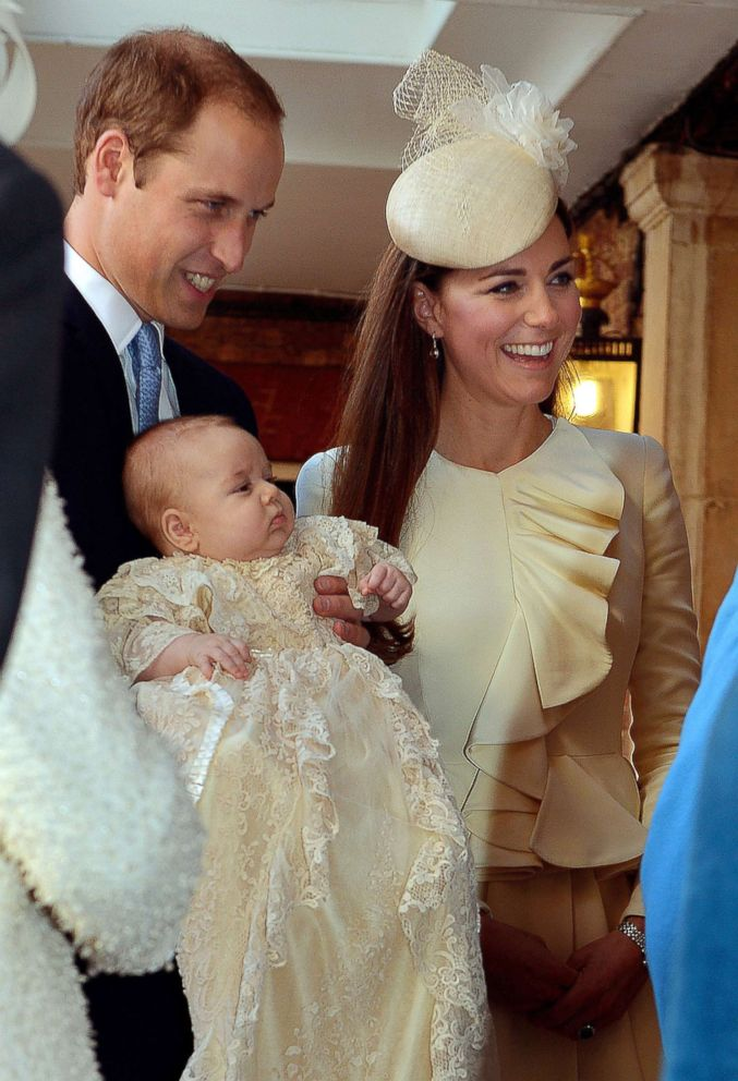 PHOTO: Prince William and his wife Catherine, Duchess of Cambridge, arrive with their son Prince George at Chapel Royal in St Jamess Palace in central London on Oct. 23, 2013, ahead of the christening of the three month-old prince.