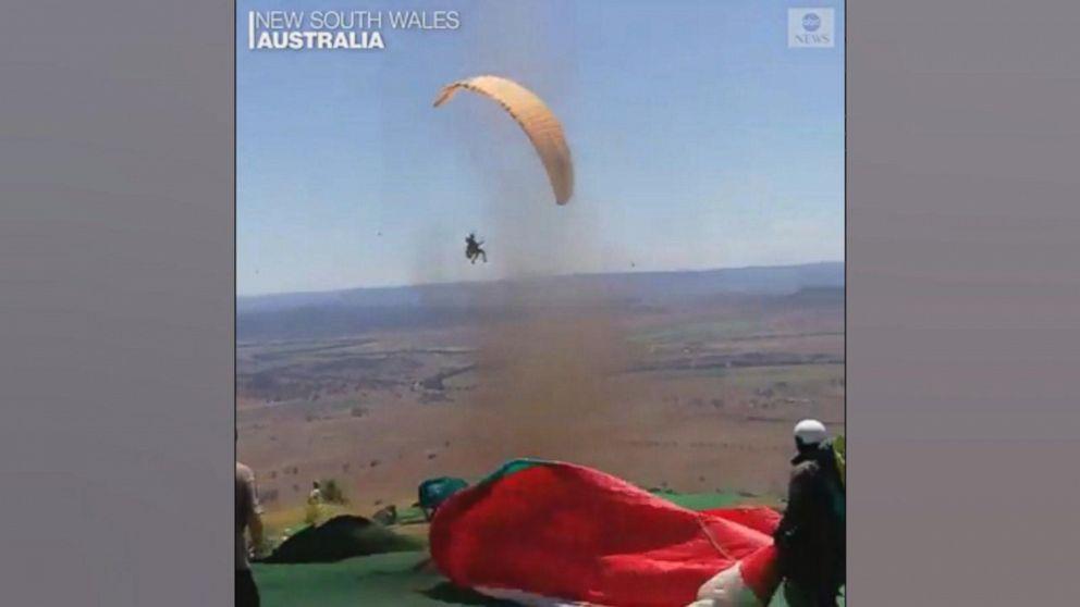 Dust devil takes paraglider pilot for a ride