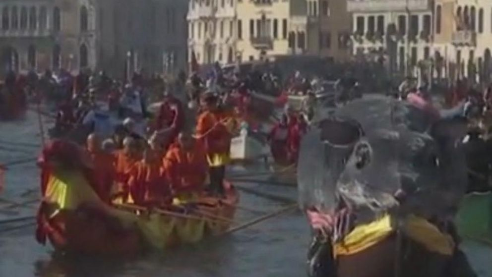 Gondolas wind through Venice for carnival