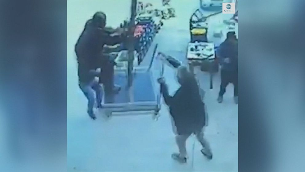 Surveillance footage captures moment strong winds lifted a man into the air as he tried to stop a patio umbrella from falling over.