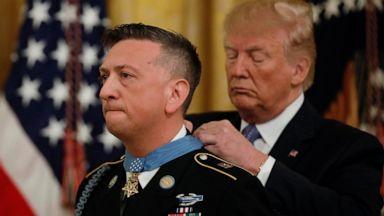 VIDEO: Medal of Honor, migrant bodies, Glastonbury: World in Photos, June 26