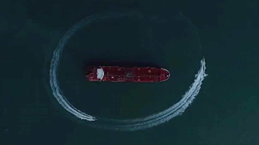 Drone footage shows boats circling British-flagged tanker captured by Iran