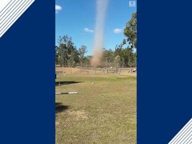 WATCH Dust devil swirls through Queensland ranch