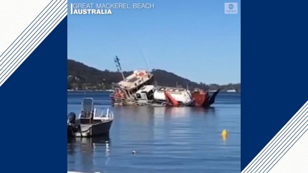 Barge carrying sewage truck capsizes in Australia