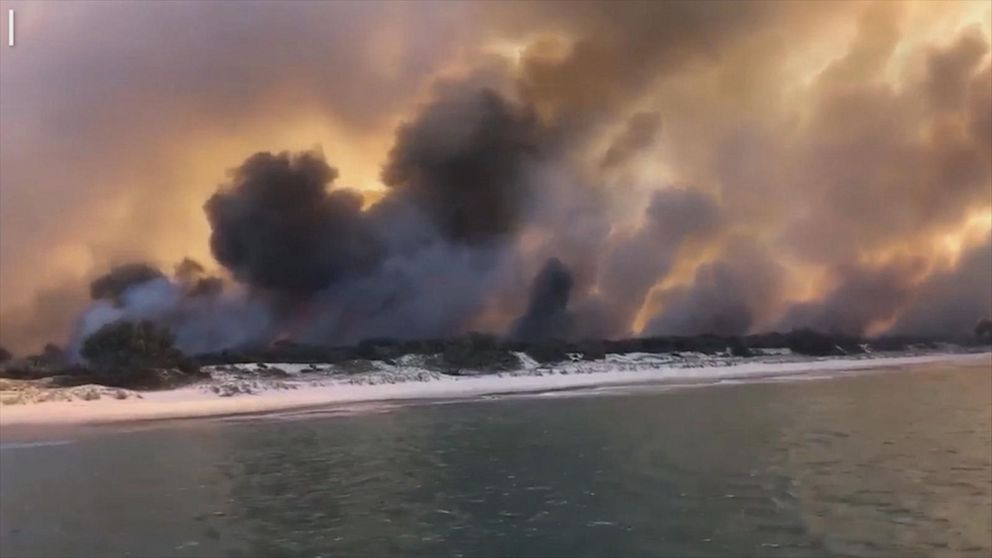 Raging wildfire engulfs Queensland island, causing evacuations