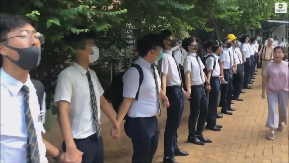 Holding hands, students show their support for pro-democracy