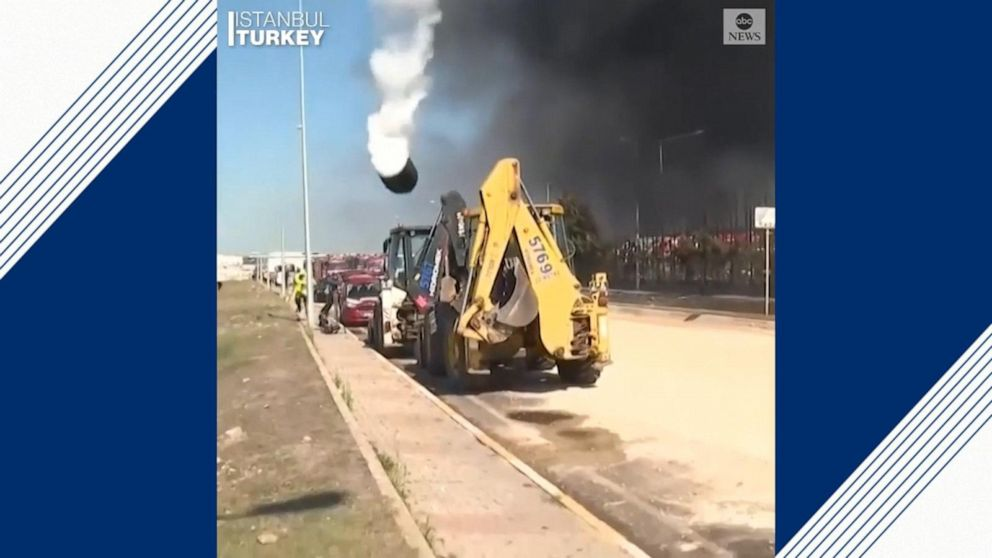 Panic as tank explodes, sending debris into sky