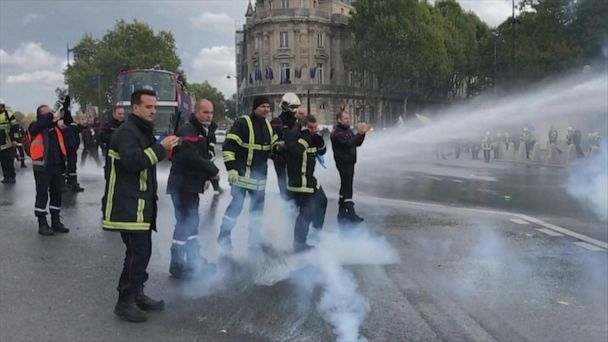 Police use water cannons against firefighters protesting in France