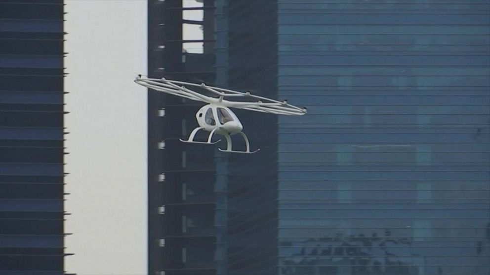 A German aviation firm's electric air taxi takes a 2-minute test flight in Singapore