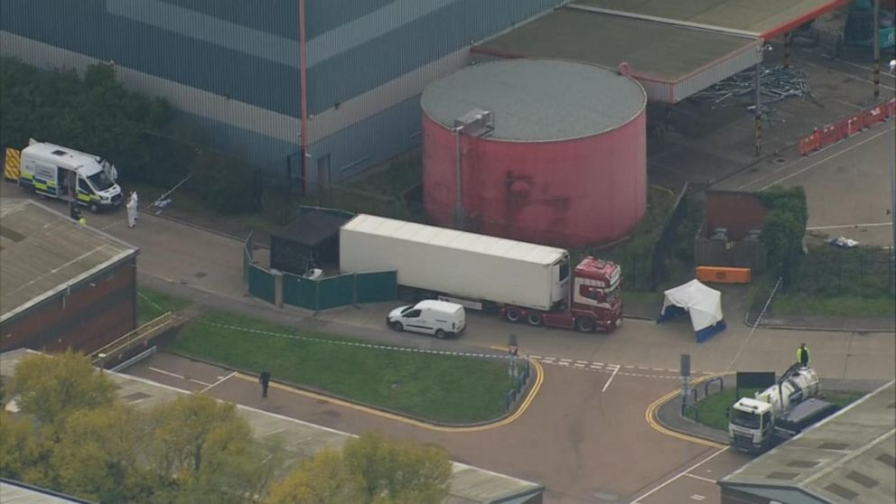 Driver arrested after 39 bodies found in tractor-trailer near London, police say