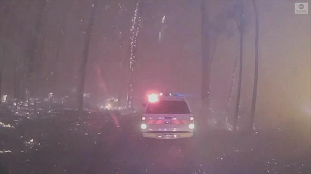 Australian firefighters drive into flames