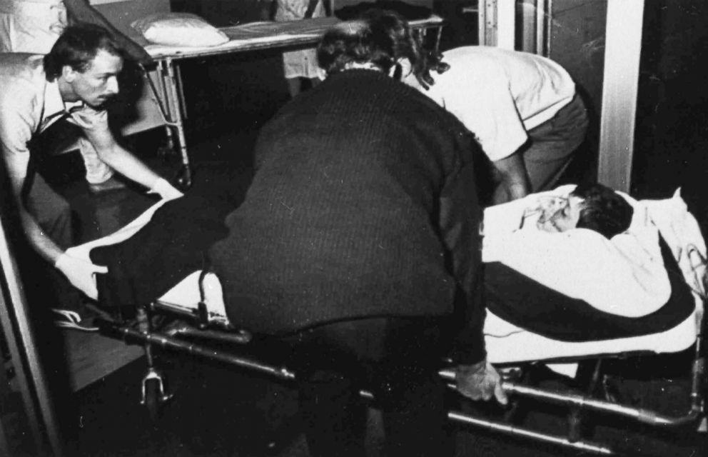 PHOTO: Ambulance officers transfer a boy to Dunedin Public Hospital, New Zealand, Nov. 14, 1990, after he had been shot in Aramoana. David Gray went on a rampage, killing 12 people, including four children and a police officer.