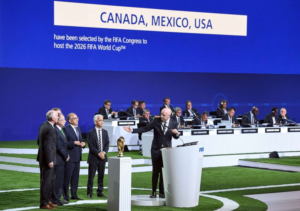 PHOTO: FIFA president Gianni Infantino (R) addresses the United 2026 bid (Canada-Mexico-US) officials following the announcement of the 2026 World Cup host during the 68th FIFA Congress at the Expocentre, June 13, 2018, in Moscow.