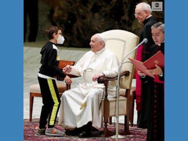 WATCH:  Boy tries to take Pope's cap