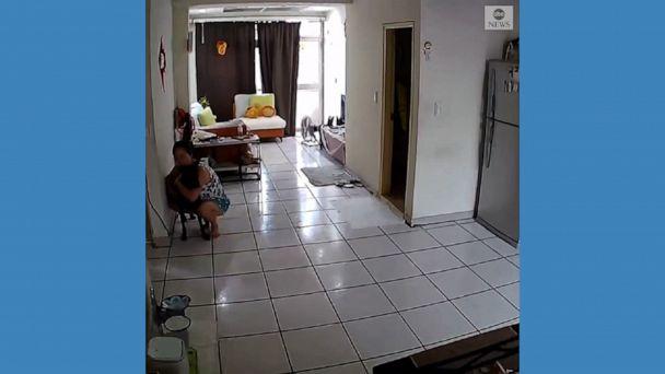 Video Woman rushes to hug dog amid earthquake