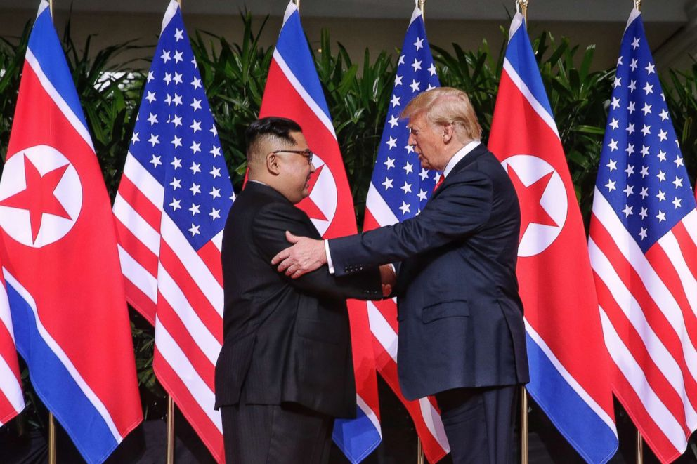 PHOTO: North Korean leader Kim Jong-un shakes hands with President Donald Trump during their historic U.S.-DPRK summit at the Capella Hotel on Sentosa island on June 12, 2018 in Singapore.