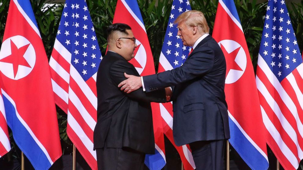 North Korean leader Kim Jong-un shakes hands with President Donald Trump during their historic U.S.-DPRK summit at the Capella Hotel on Sentosa island on June 12, 2018 in Singapore.